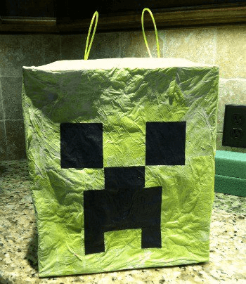 You will be shocked at how easy it is to Make a Minecraft Pinata. Your kids will love this easy diy minecraft pinata at their next party. Learn how to make a minecraft pinata. Try these minecraft decorations at your next Minecraft birthday party!