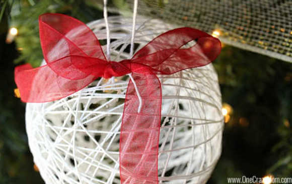 Learn how to make a string ornament. It is so easy to make DIY Christmas Ornaments and budget friendly when all the supplies are from the Dollar Store!