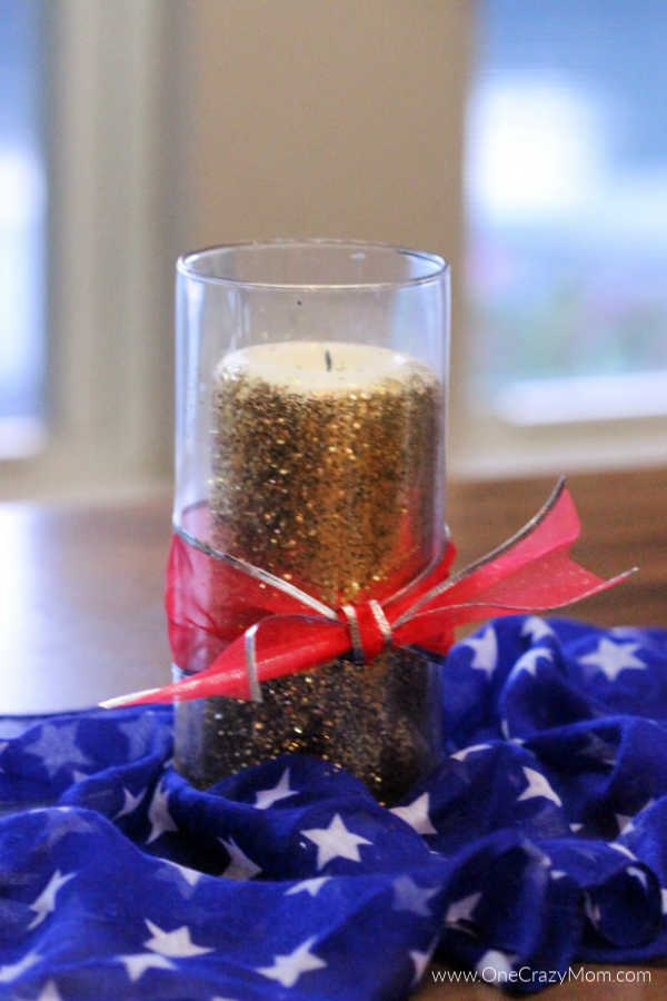 Make a patriotic 4th of July centerpiece for only $6! This adorable dollar store centerpiece will be the star of the show and so gorgeous on your table.