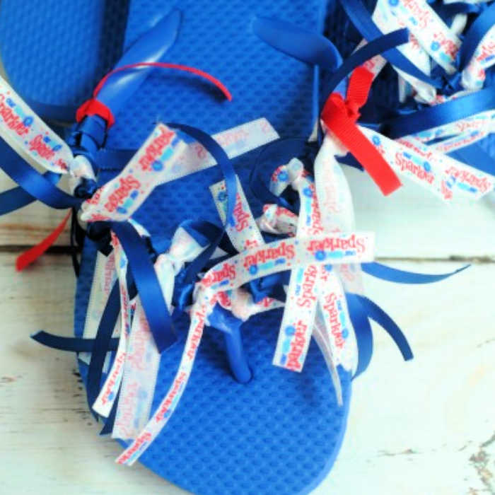 Make these Patriotic ribbon flip flops for less than $5 and in just 20 minutes! Jazz up plain flip flops and turn then into4th of july flip flops.