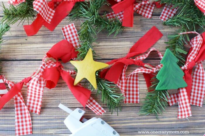 Garland makes your home festive for Christmas. DIY Christmas garland is perfect for the mantle or anywhere you need a festive touch. It's so easy to make!