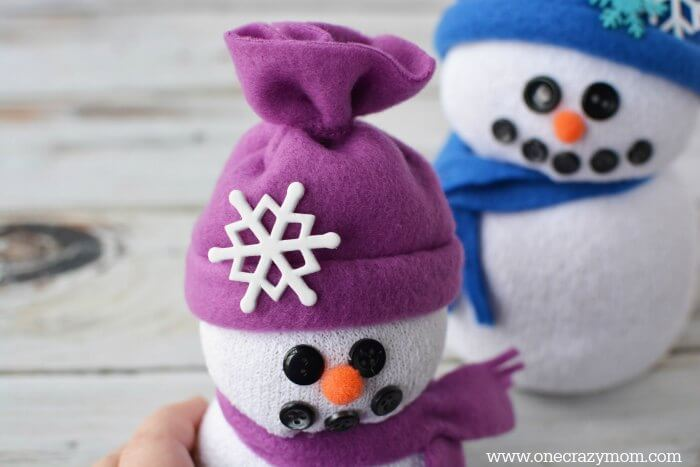 You will love learning how to make sock crafts! Find out how to make a snowman made out of socks. This DIY Sock Snowman craft is so cute and simple to make!