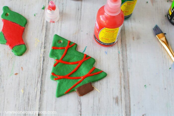 Make special memories with this simple and fun Salt Dough Ornament Recipe for Christmas. Learn how to make salt dough ornaments so easy the entire family can help! This great ornament DIY is perfect for kids. #onecrazymom #christmasornaments #DIYornaments #saltdoughornaments