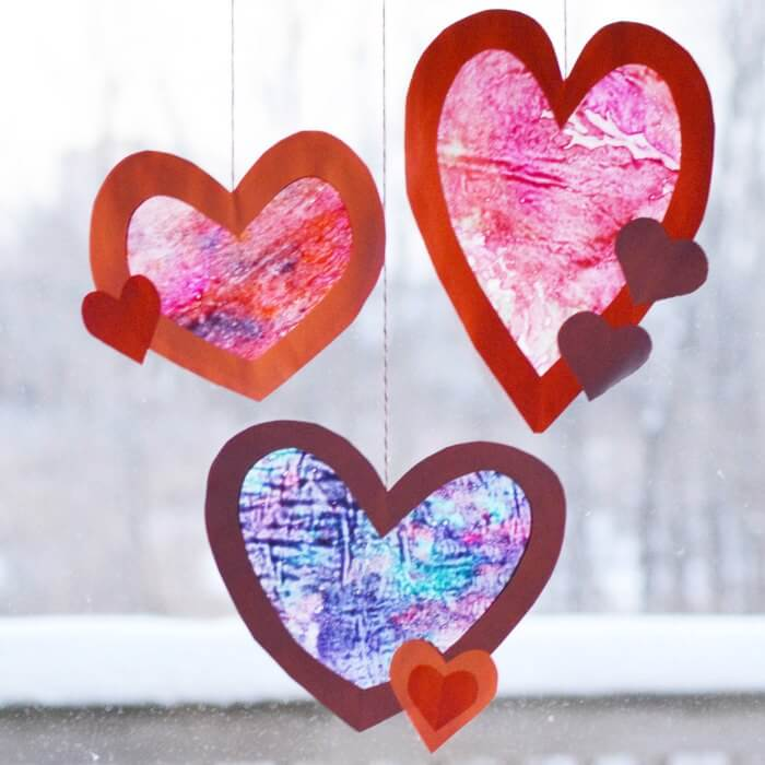 valentine s day craft learn how to make a heart suncatcher