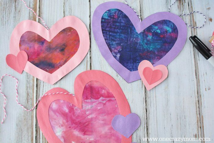 Let the kids make a homemade suncatcher for the perfect Valentine's Day Craft. They will love this <a href=