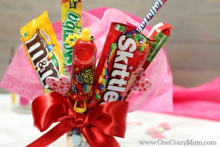 This Candy Bouquet DIY is a fun Valentine's Day gift idea! Learn how to make this Easy Candy Bouquet quickly. Make this fun Candy Arrangement today.