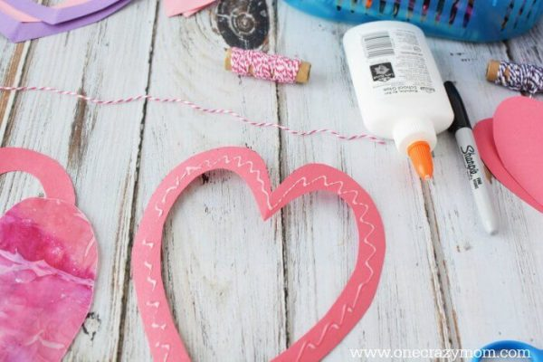 Let the kids make homemade suncatchers for the perfect Valentine's Day Craft. They will love this heart suncatcher and it's so simple to make.