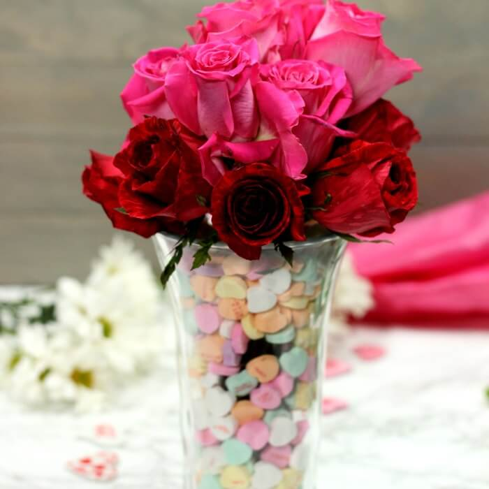 Make this super cute Valentine's Day Centerpiece. This easy DIY Valentine's Day Decor can be created for any holiday! Take those heart candy and decorate with them!