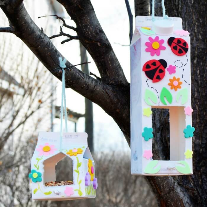 This Homemade Bird Feeder is so fun to make. Use milk cartons to make this DIY Bird feeder. Learn how to make a homemade birdfeeder with what you have at home. Kids will love helping!