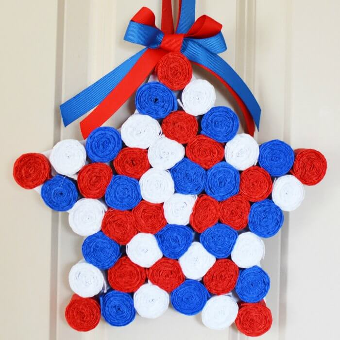 This 4th of July wreath is made with crepe paper and takes very little time to make! The red, white and blue look so patriotic. Try this Fourth of July wreath! You can also use it for Memorial Day! Quick and Easy July 4th Wreath.