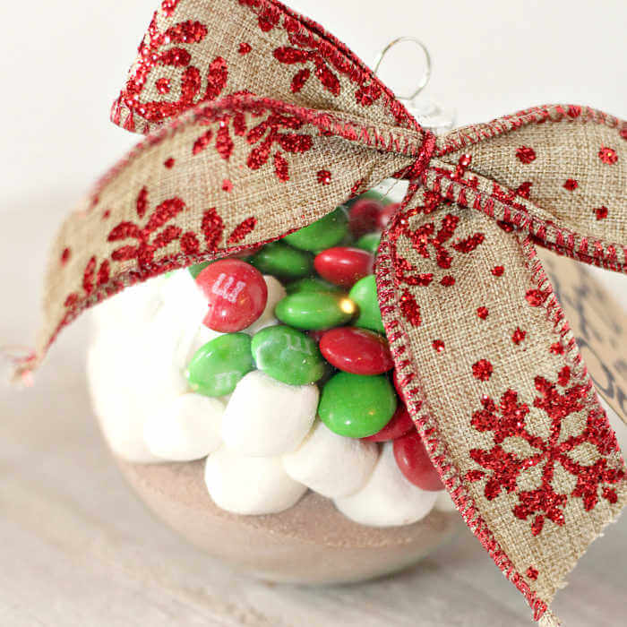 This easy Hot Cocoa Ornament is one of our favorite Hot Chocolate Gift Ideas. Individual hot chocolate gifts make such a thoughtful gift everyone will love!