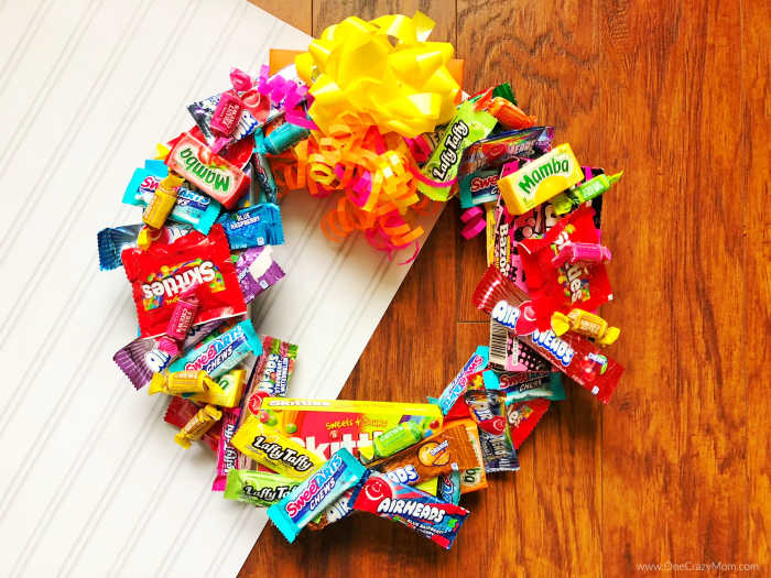 Learn how to make a candy wreath that everyone will love. This easy candy wreath is so fun and a great gift for any occasion. Try this fun and frugal idea.
