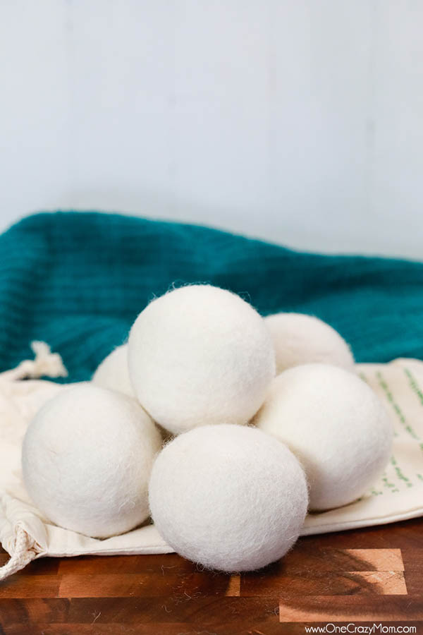 Learn how to use wool dryer balls instead of dryer sheets for a chemical free alternative to softer clothes. Wool dryer balls also help dry clothes quicker.