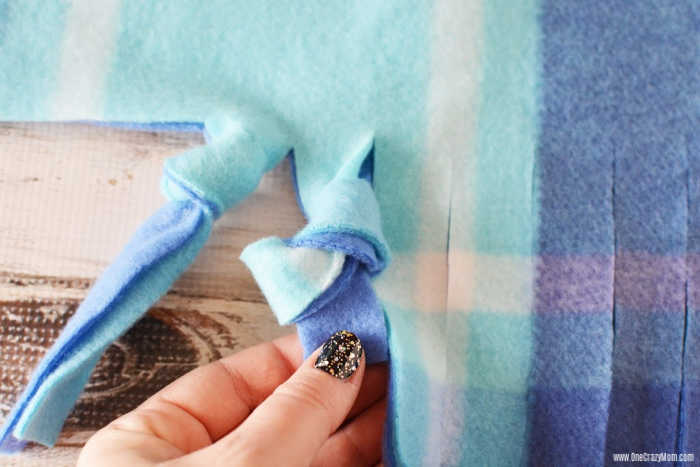 Learn how to make a fleece tie blanket for the perfect afternoon DIY activity. This no sew fleece blanket is so easy to make and perfect for gift giving.
