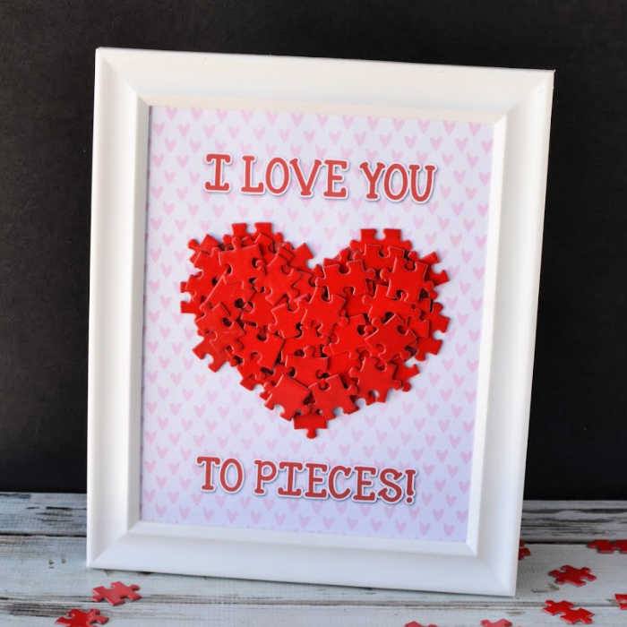 I love you to pieces sentiment card with jigsaw pieces of pink and white hearts