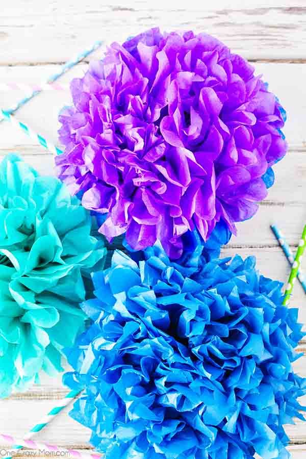 Tissue paper pom poms are so pretty for birthday parties, baby showers and more. Learn how to make these easily with dollar store supplies.