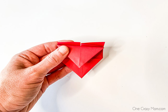 Learn how to make an Origami Heart with these easy step by step instructions. This is such a simple DIY but tons of fun and a great activity for the kids.