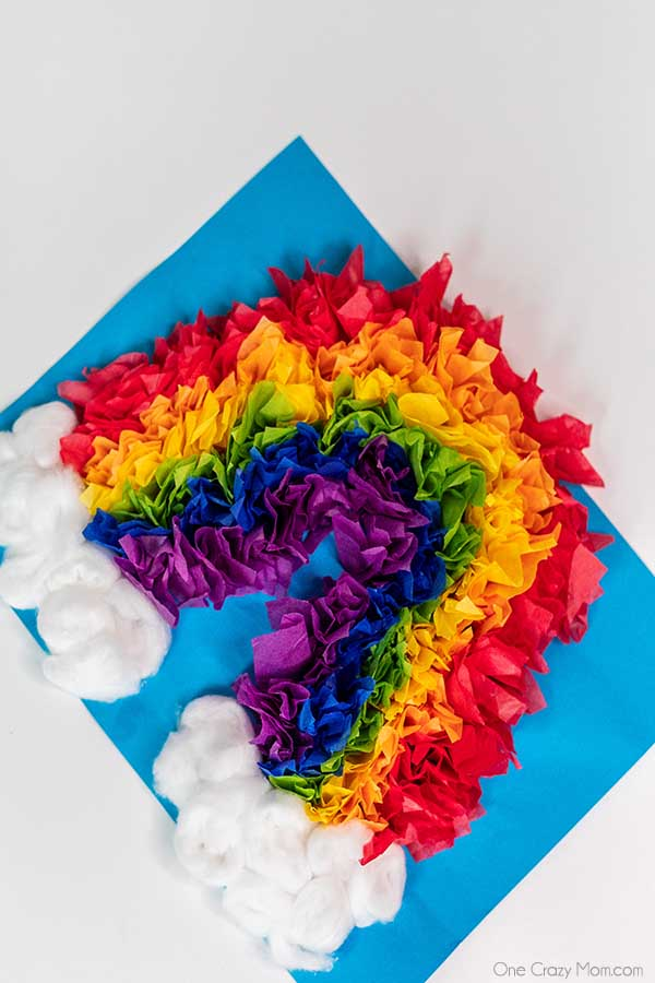 Make this colorful rainbow tissue paper craft for the perfect indoor activity. Easy rainbow crafts are so fun and a great learning activity.