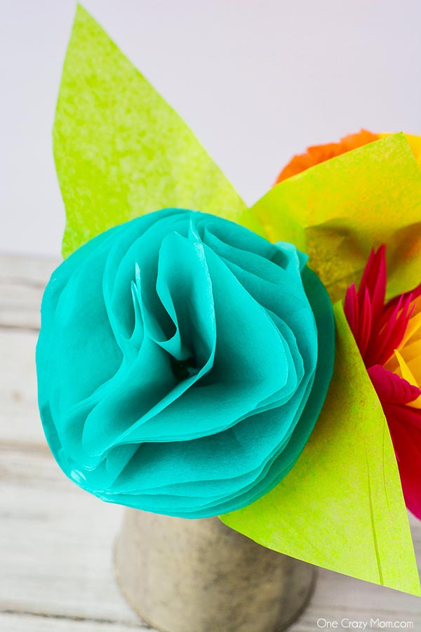 Tissue paper flowers are so simple to make and you can use any color combination you like. These are perfect for room decor, parties and more!